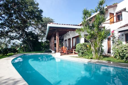 The classic Mediterranean style and lush gardens of Villa Artemis envelops guests in an exotic, homey ambiance. This charming 4 bedroom, 4 bathroom home is located on one of the highest hills in Playa Tamarindo.