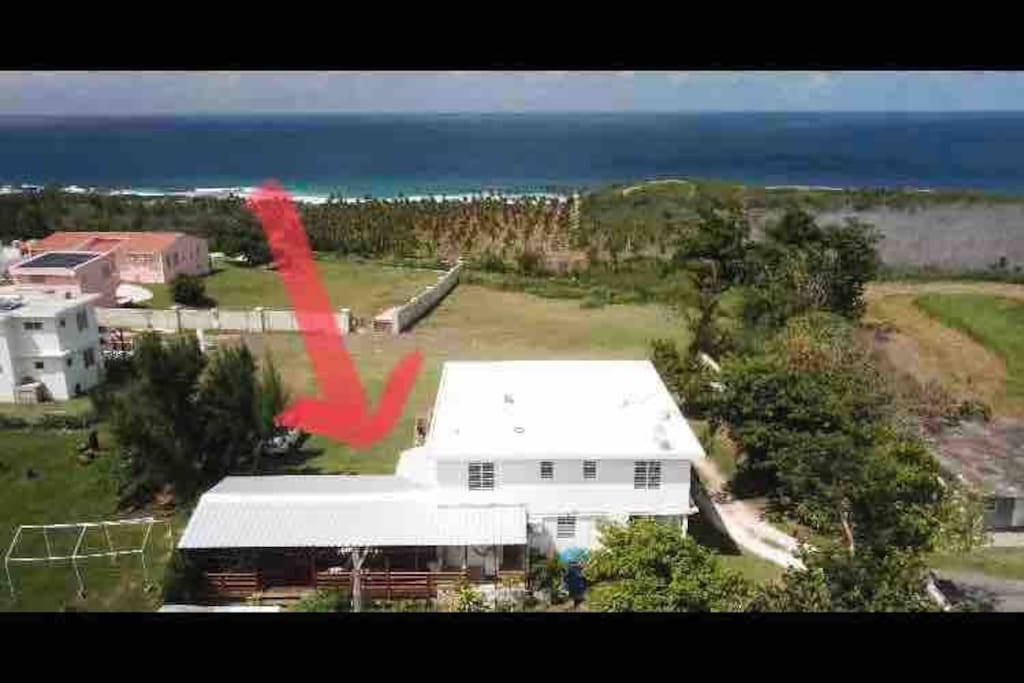 This is an aerial of view of Ocean Avenue Guest House. Studio verde is located on the left side of the house where there is also a large outdoor deck.