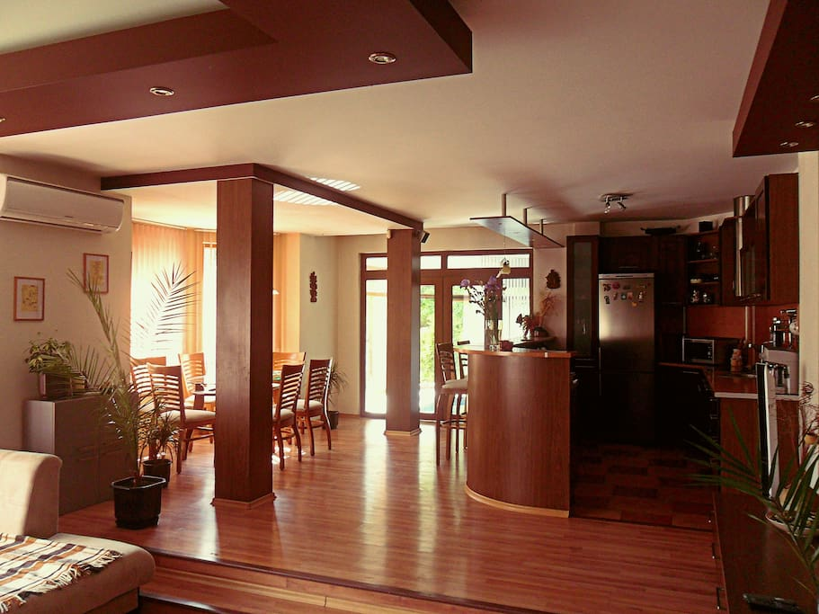 A large living room sits just beyond the kitchen bar