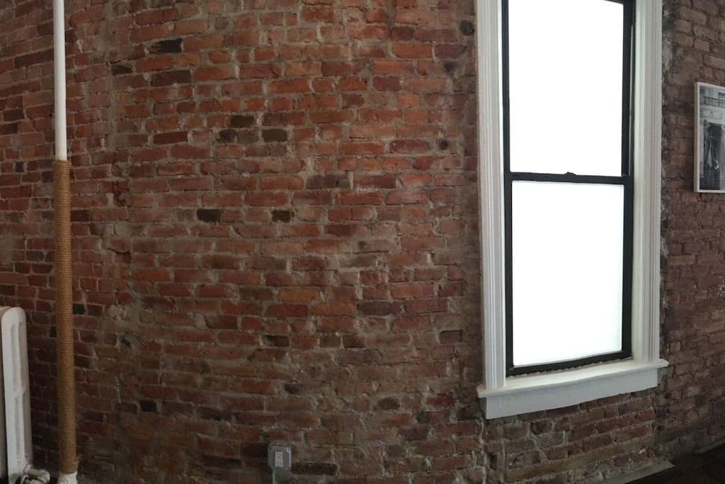 A partial panorama of the east wall.  The entire space is more than 60' long!