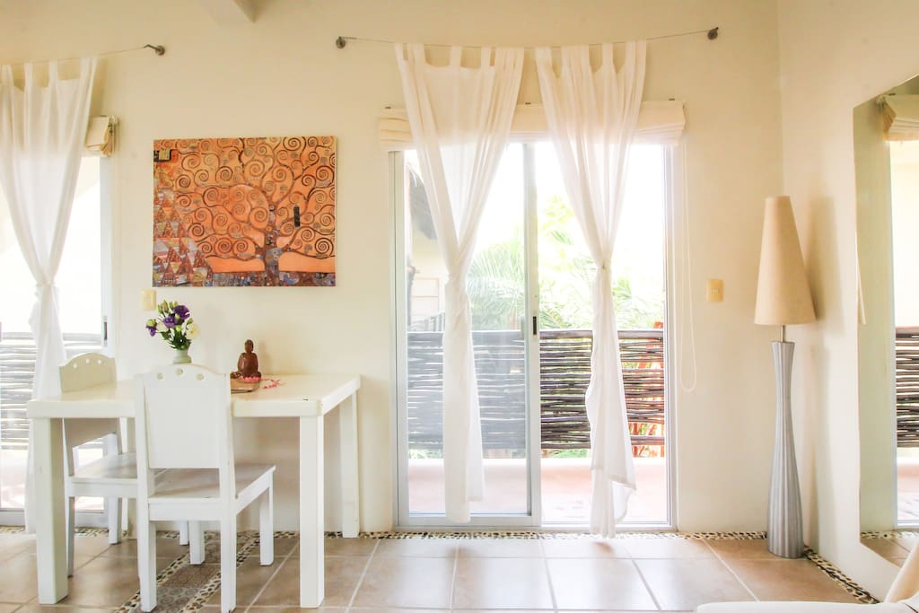 Sitting table / Double sliding glass doors to your balcony