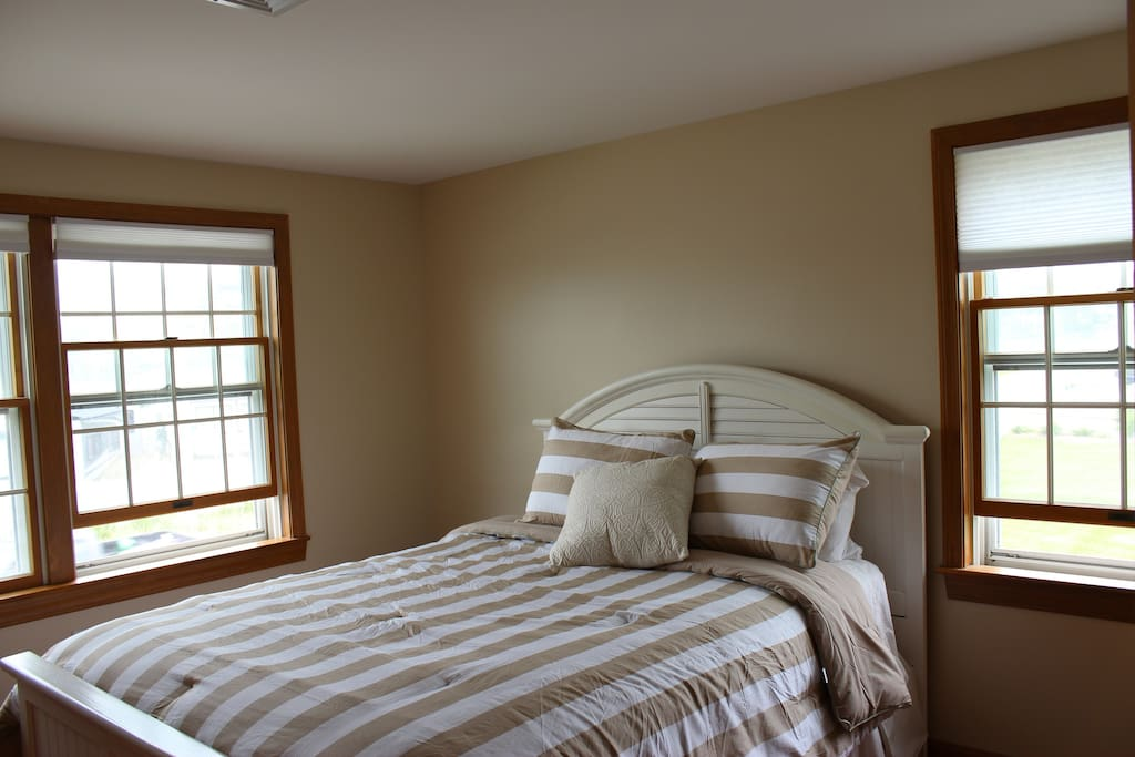 Upstairs middle bedroom, queen bed. Sleeps 2.