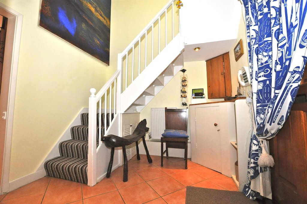 Entrance hall showing stairs up to your room.