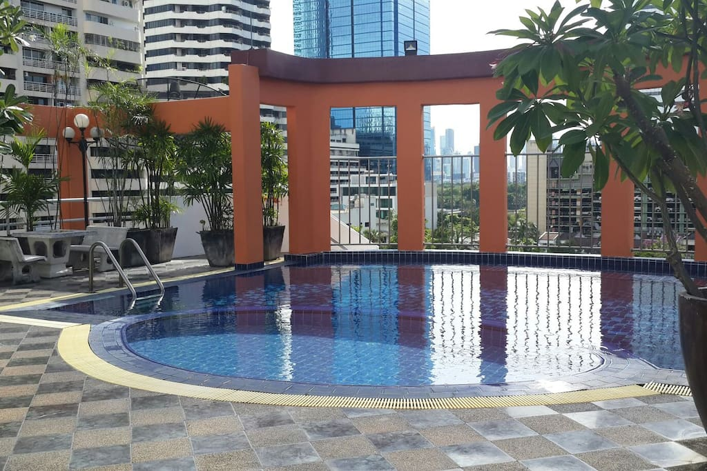 pool with hi and lo part and tables shade gym ping pong on roof with wow view middle bkk