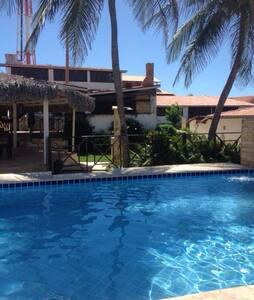 Lägenhet med pool och strandnära!