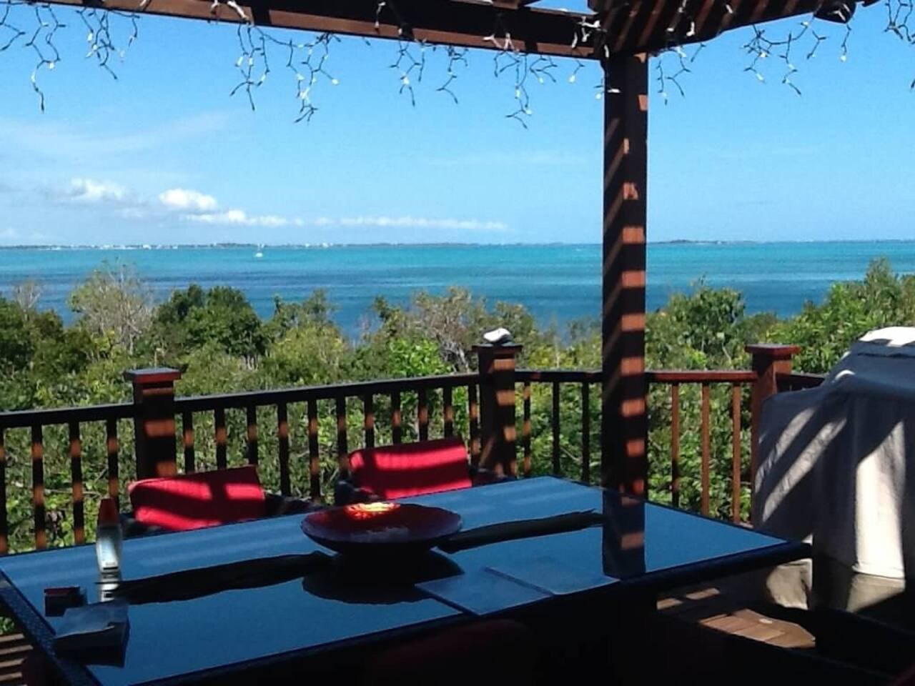 Upper deck outside dining with view of the Sea of Abaco