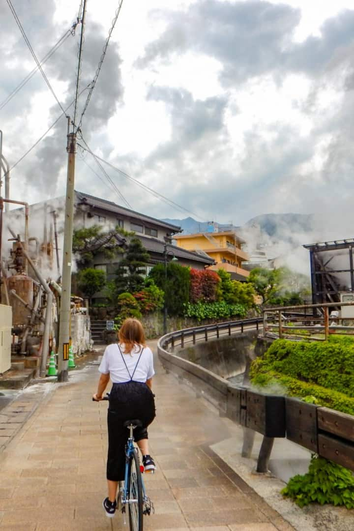 Cycling through an onsen steaming road!