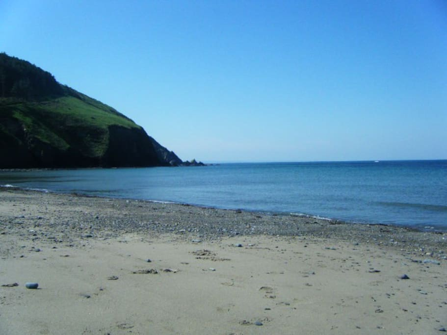 The beach is a short walk from the Chalet