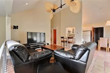 The main lounging area & a peek into the kitchen--including an intimate eating ledge.