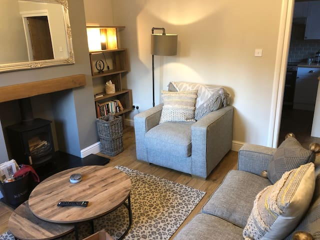 Lounge with log fire and smart TV