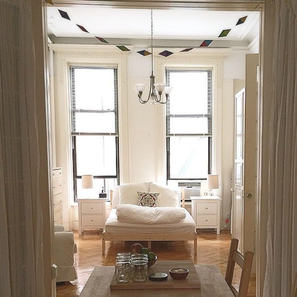 This quiet, sun-drenched bedroom off the back of the brownstone leads to a complete kitchen and private bathroom with an antique sink and full-size tub.