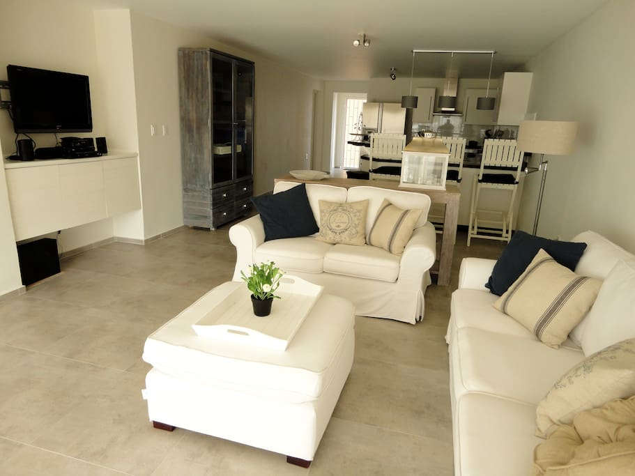 The spacious living room with open kitchen provides seating for at least 6 people. In the living room is also a flat screen television, DVD player and an amplifier for your iPod or iPhone.