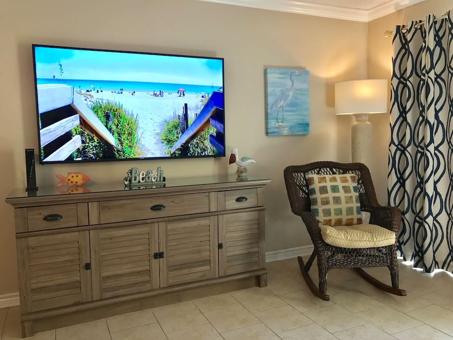 """Living Room with 65"""" high definition TV and Blue-Ray player"""