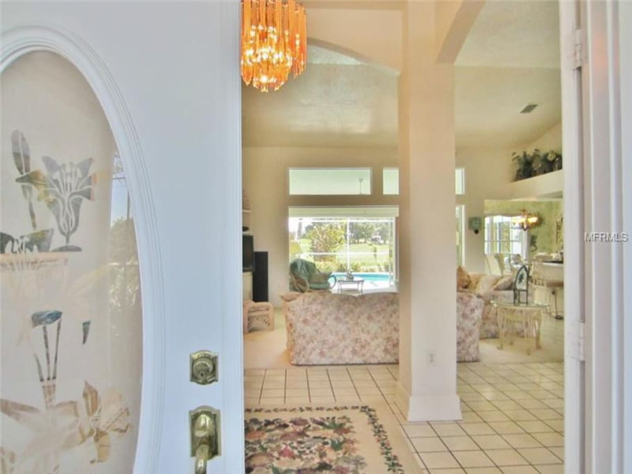 First view is through the expansive livingroom to the lanai, pool, then golf course.