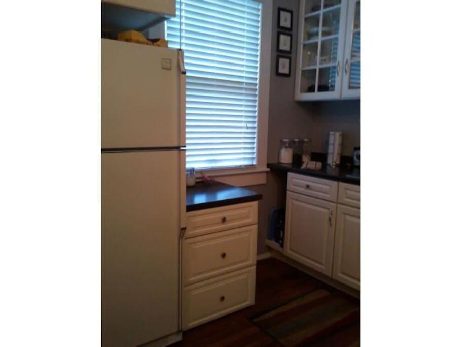 Shared kitchen, with refrigerator, sink, dishwasher.