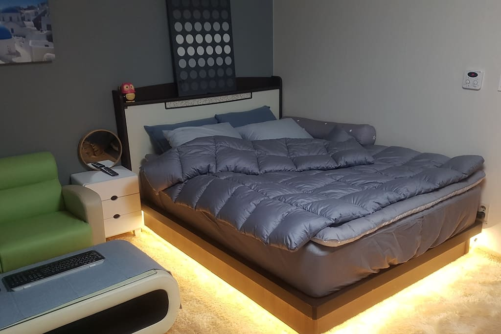 #Main Bed Room (1 Queen size bed with LED light, Sofa, TV, Make up Table, Coat Hanger)