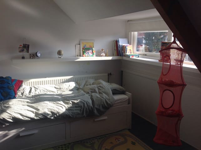 Bedroom on 2nd Floor. Enough toys for kids to enjoy theirselves! They are welcome to play with lego, Barbie and much more.