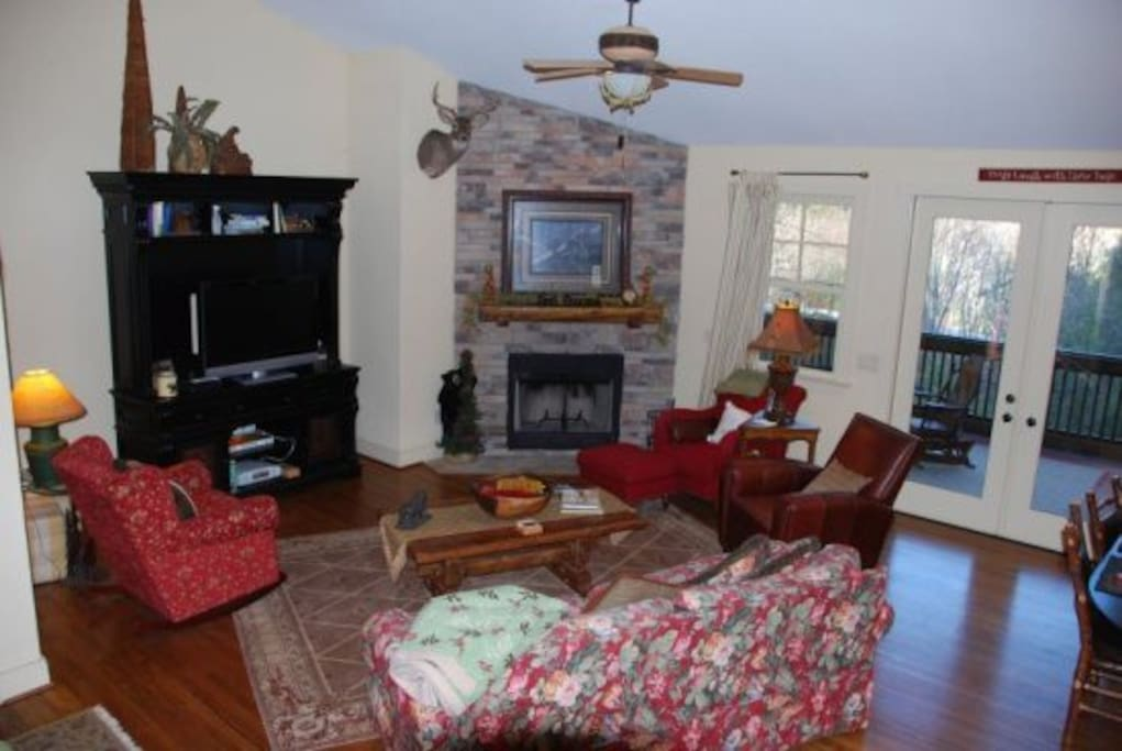 Living room with fireplace and access to screened in back porch