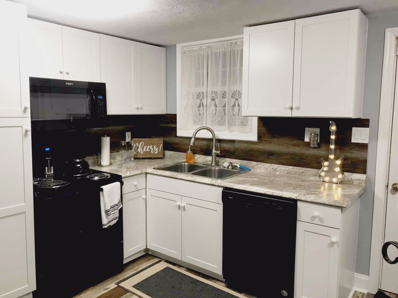 Remodeled Kitchen with New Cabinets, Dishwasher, counters, sink and more.