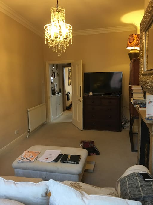 Front lounge with TV and drinks cabinet!