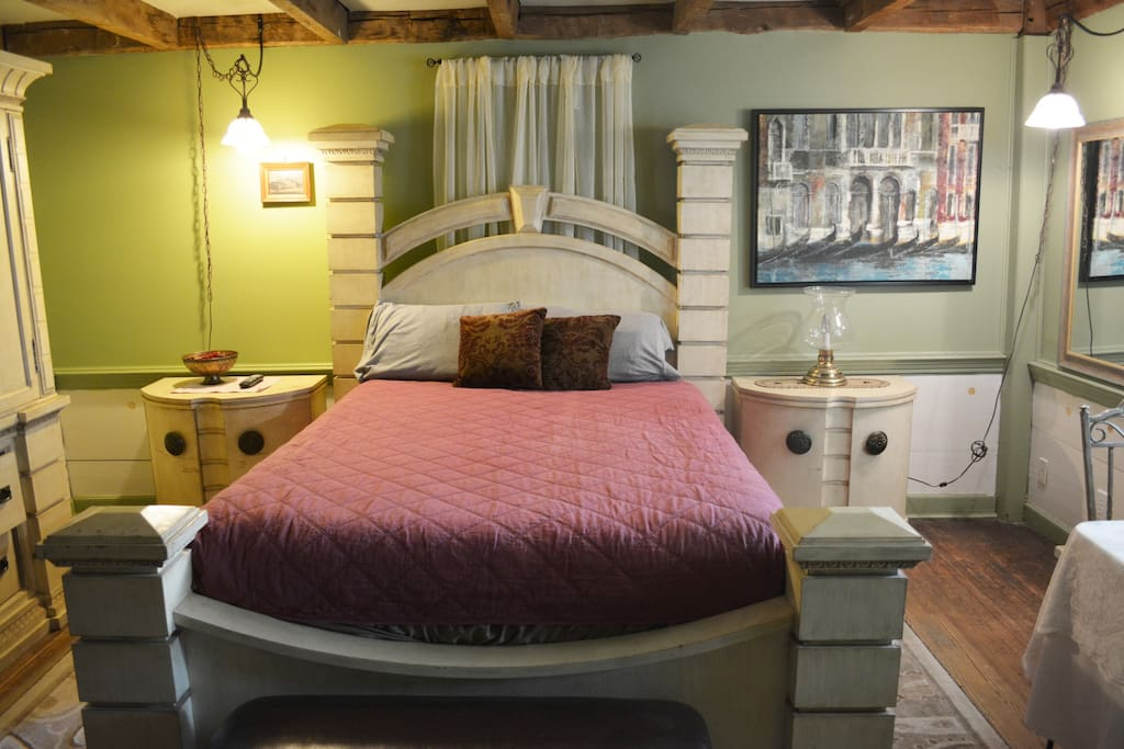 Bedroom One - Classic cottage feel to this cozy and warm room.  Working propane log fireplace.