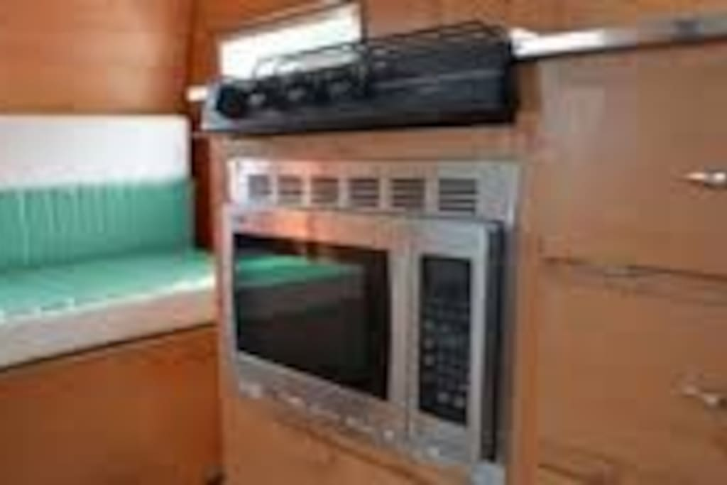 Modern amenities, microwave, gas stove top, Ipod charger station and more