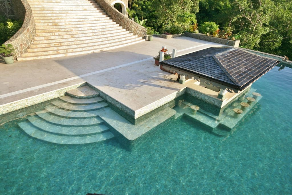 The Pool House lies adjacent to the Infinity Pool and one of it's entrance's is through the Pool Bar