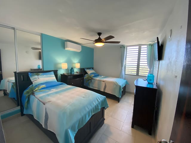 Vibrant beach themed bedroom with twin beds