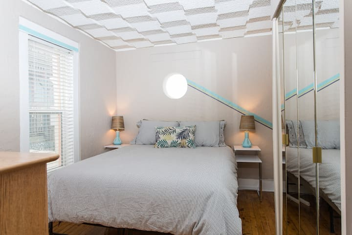 Cozy bedroom features Queen-size memory foam mattress, dresser, closet and side tables with reading lights.