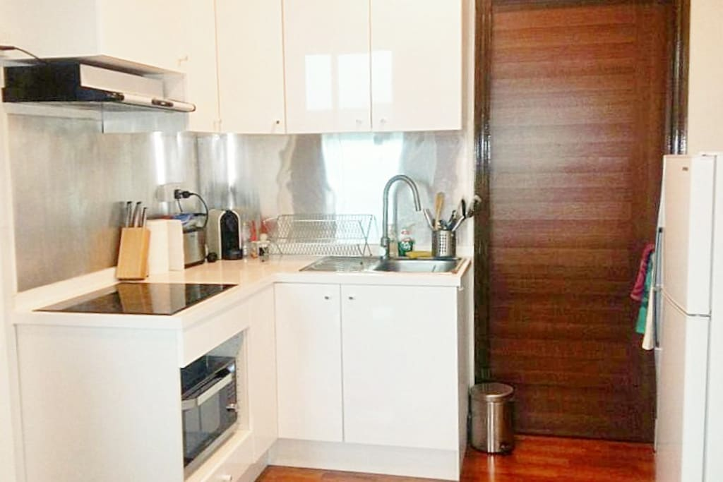 Kitchenette is fully equipped with microwave convection oven, stove, stove, refrigerator.