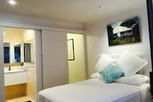 Beautiful non smoking bedroom with modern bathroom and access to full laundry.