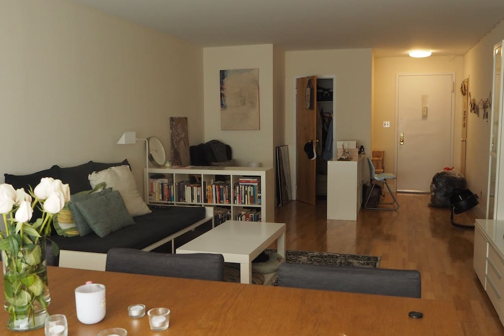 L-Shape Studio with a reading area, living room, dining room and the bedroom space tucked away.