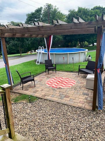 Pergola with outdoor seating (only some pictured) we also have a portable propane fire pit for entertainment!