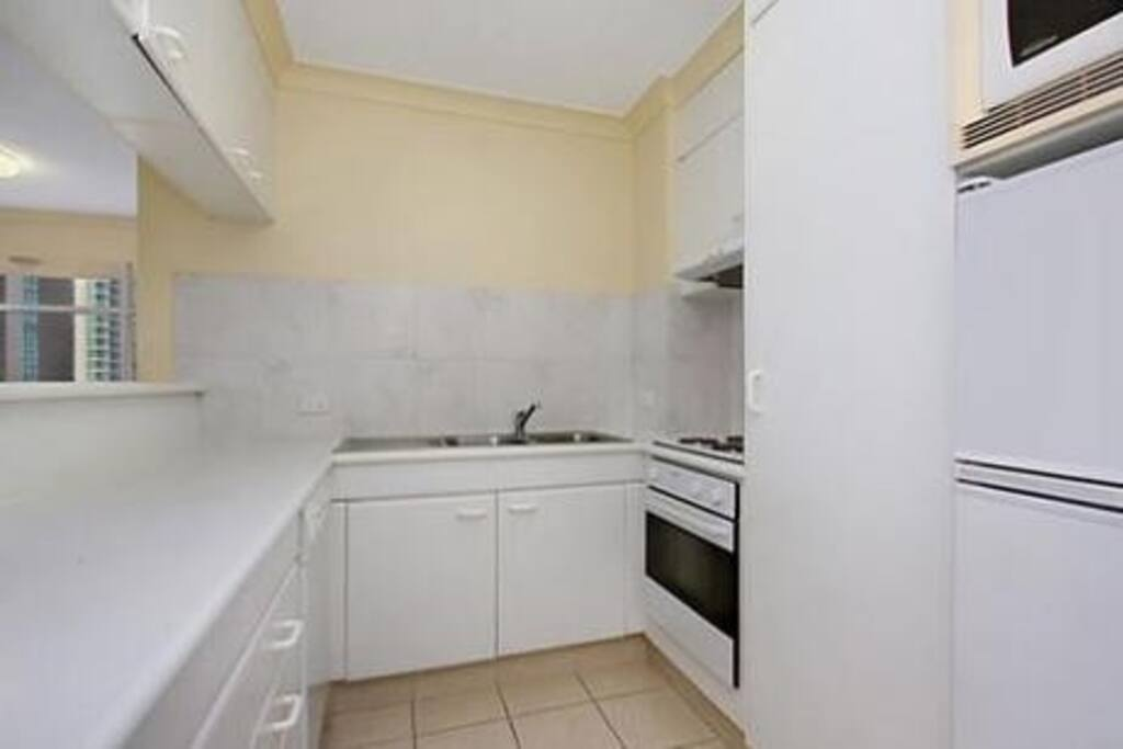Fully equipped kitchen with microwave oven
