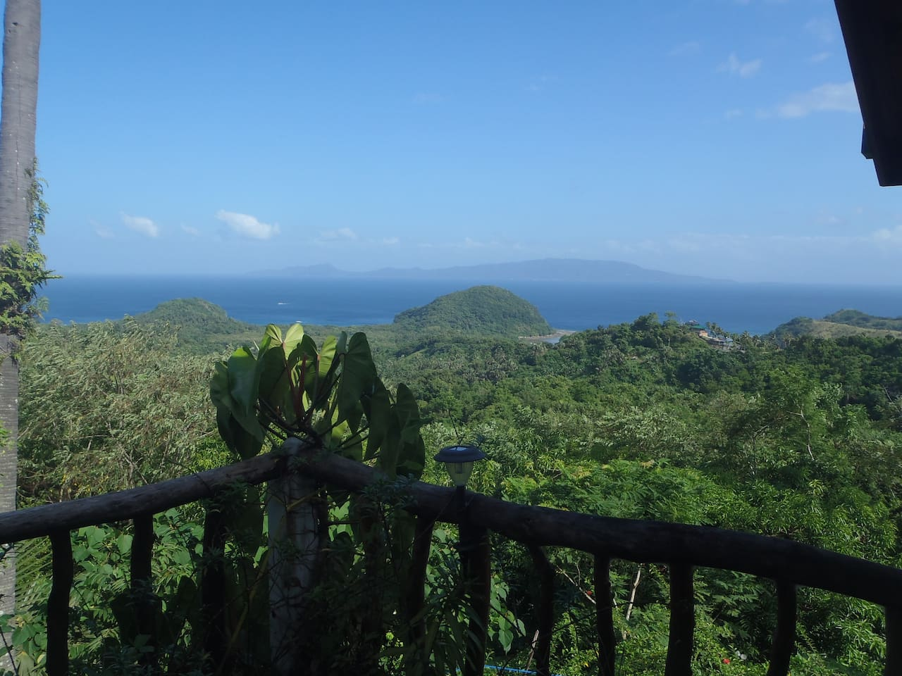 View from the verandah of jungle below i and the South China Sea beyond