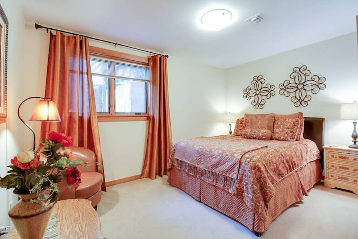 Comfy queen bed with sitting area and roomy closet.