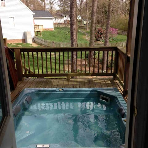 Your hottub is sunk into the deck outside your suite.
