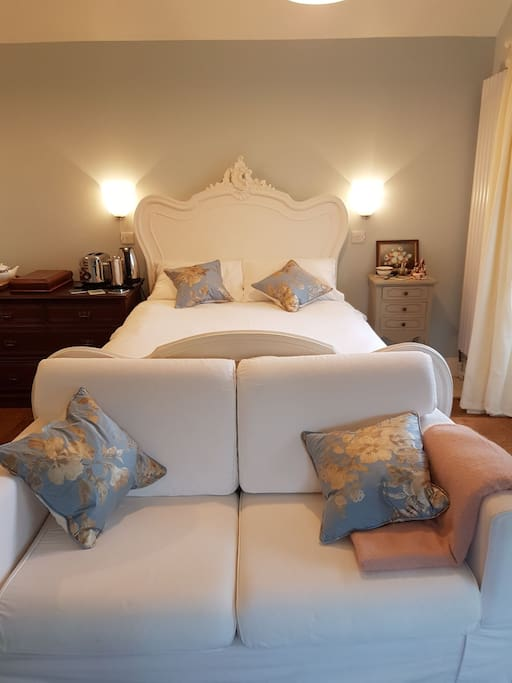 Your fabulous Louis XIV bed with a super comfy mattress and fine linens ensuring a great night's sleep.