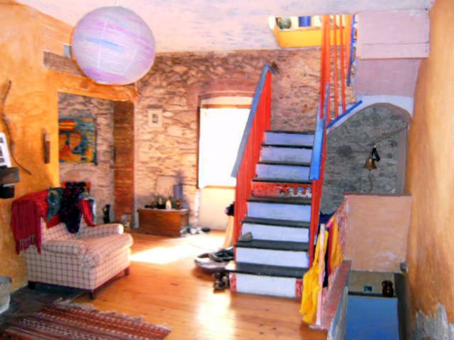 The living room and stairways to the upper floor
