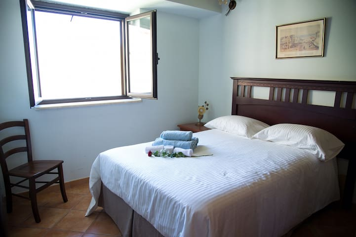 Upper level  second bedroom has a double bed with en-suite shower, toile and basin