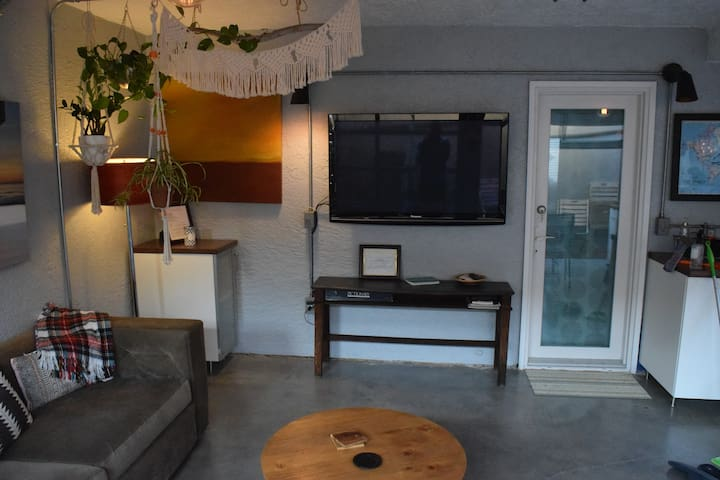 Large TV in the enclosed patio area for watching shows or movies with the Amazon Firestick with Amazon Prime Video and Netflix.