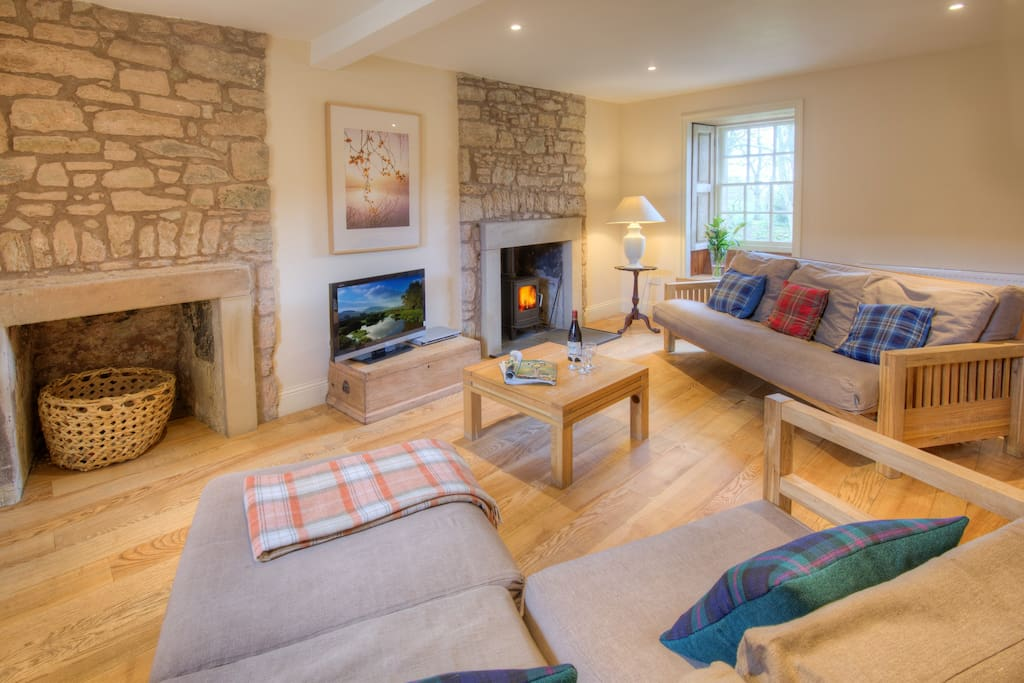 The sitting room at Keepers Cottage, with log-burning stove