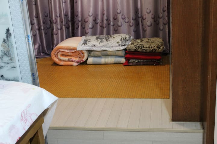 Japanese sleepers as the whole floor below, covered with Korean floor,sliding doors with chinese paintings