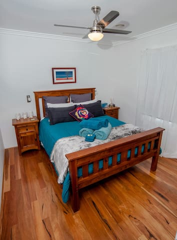 Bedroom -queen size bed, bedside tables and built-in wardrobe