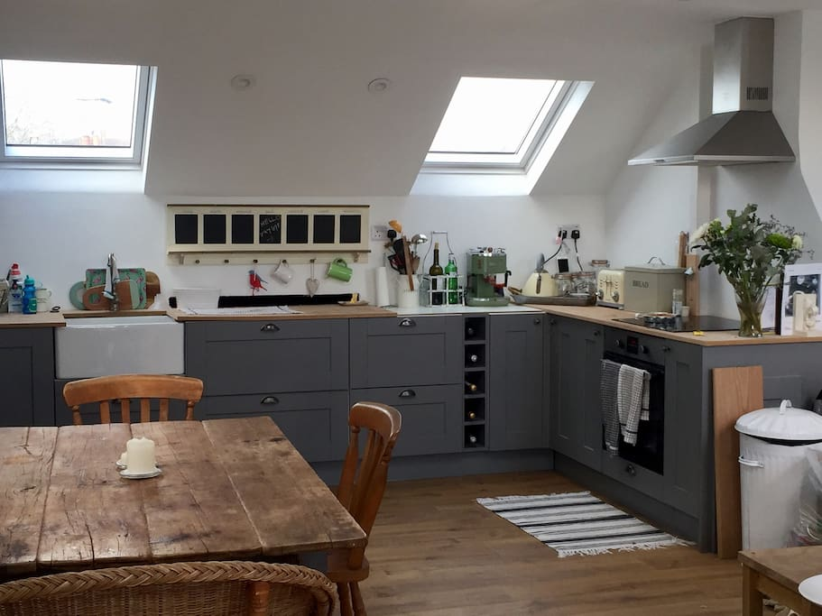 Brand new open planned and very light kitchen with built in fridge/freezer, dishwasher, oven, induction hob and all kitchen utilities - microwave, slow cooker, pots, pans, crockery and cutlery!