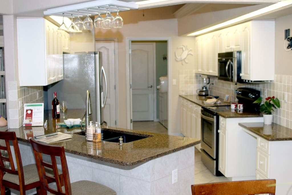 Large kitchen with Kitchen Aide stainless steel appliances.