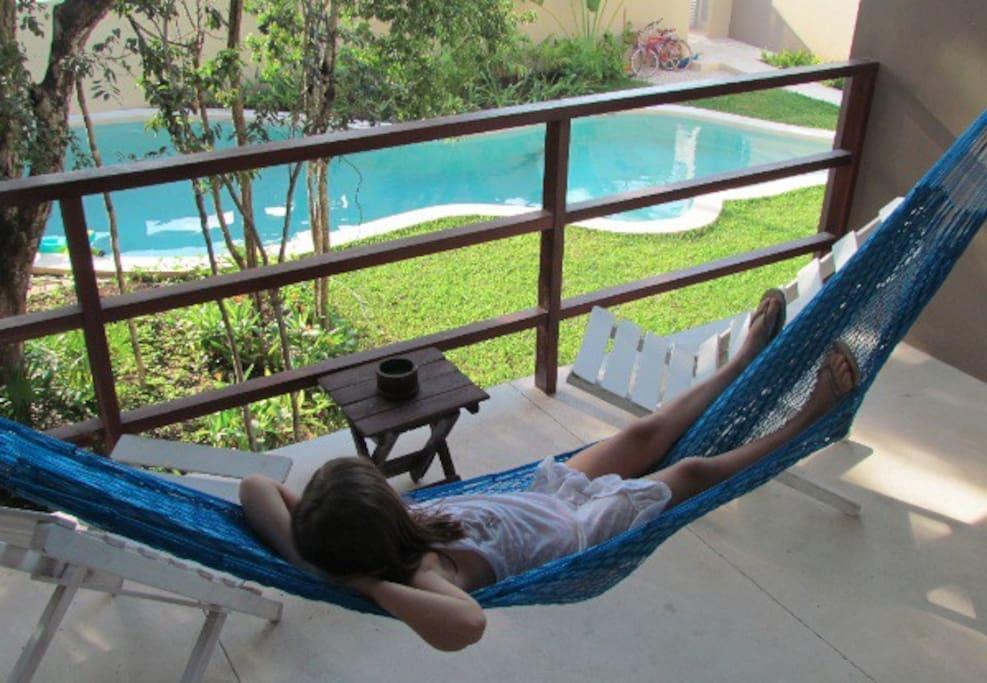 Spacious balcony overlooking tropical garden
