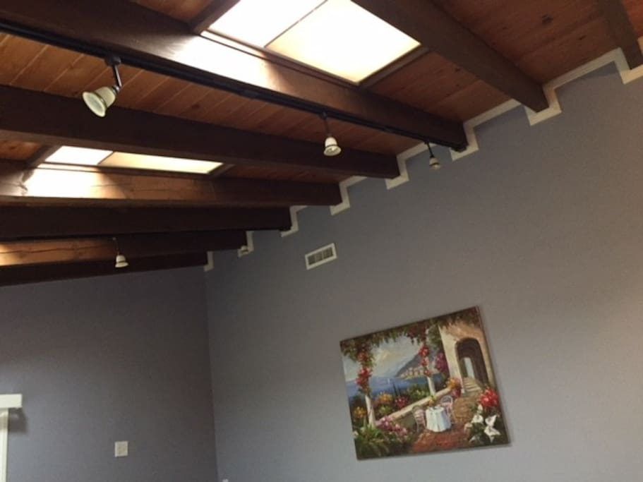 Living room has sun roof ceiling