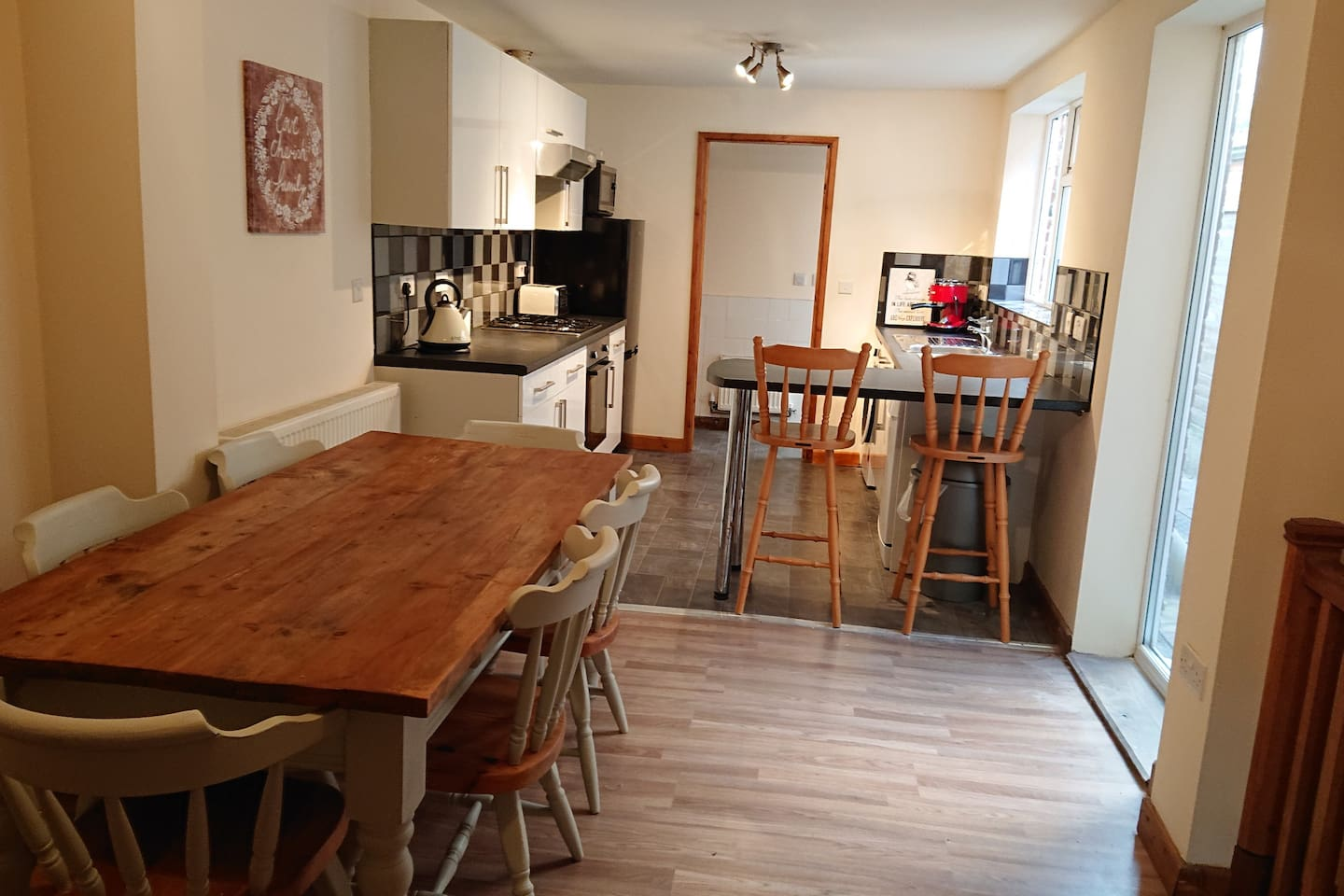 Open plan dining room and large kitchen with breakfast bar