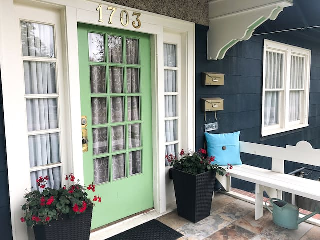 A cheery porch welcomes guests and is a  lovely place to enjoy the morning's first cup of coffee.